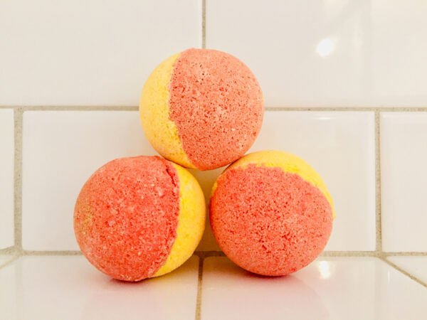 Fun bright yellow and orange bath bombs for children which reveal a toy when used.