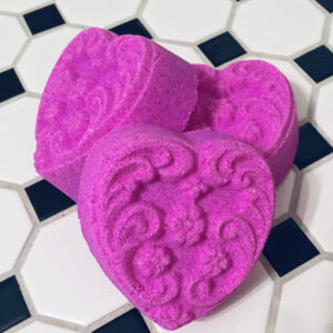 Bright pink heart shaped embossed bath bomb